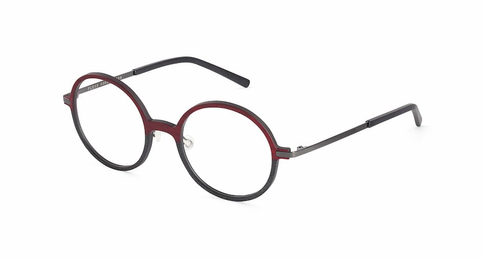 En rund brille fra Fleye med hvit bakgrunn. Fronten på brillen er delt i to farger, rød i tre og svart i karbonfiber. Brillestengene er grå.
